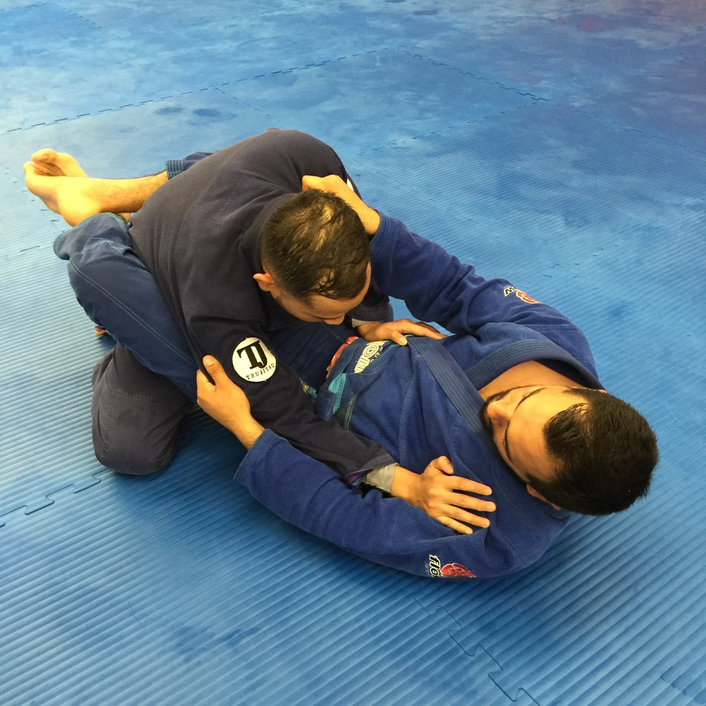 What not to do..   When your head and arms are above your opponent's belt line, you are in range for both chokes and arm attacks.