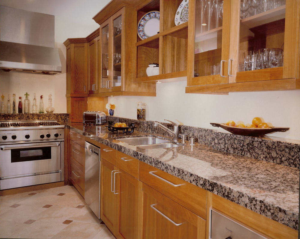 Cherry Cabinets give warmth to this galley kitchen layout.