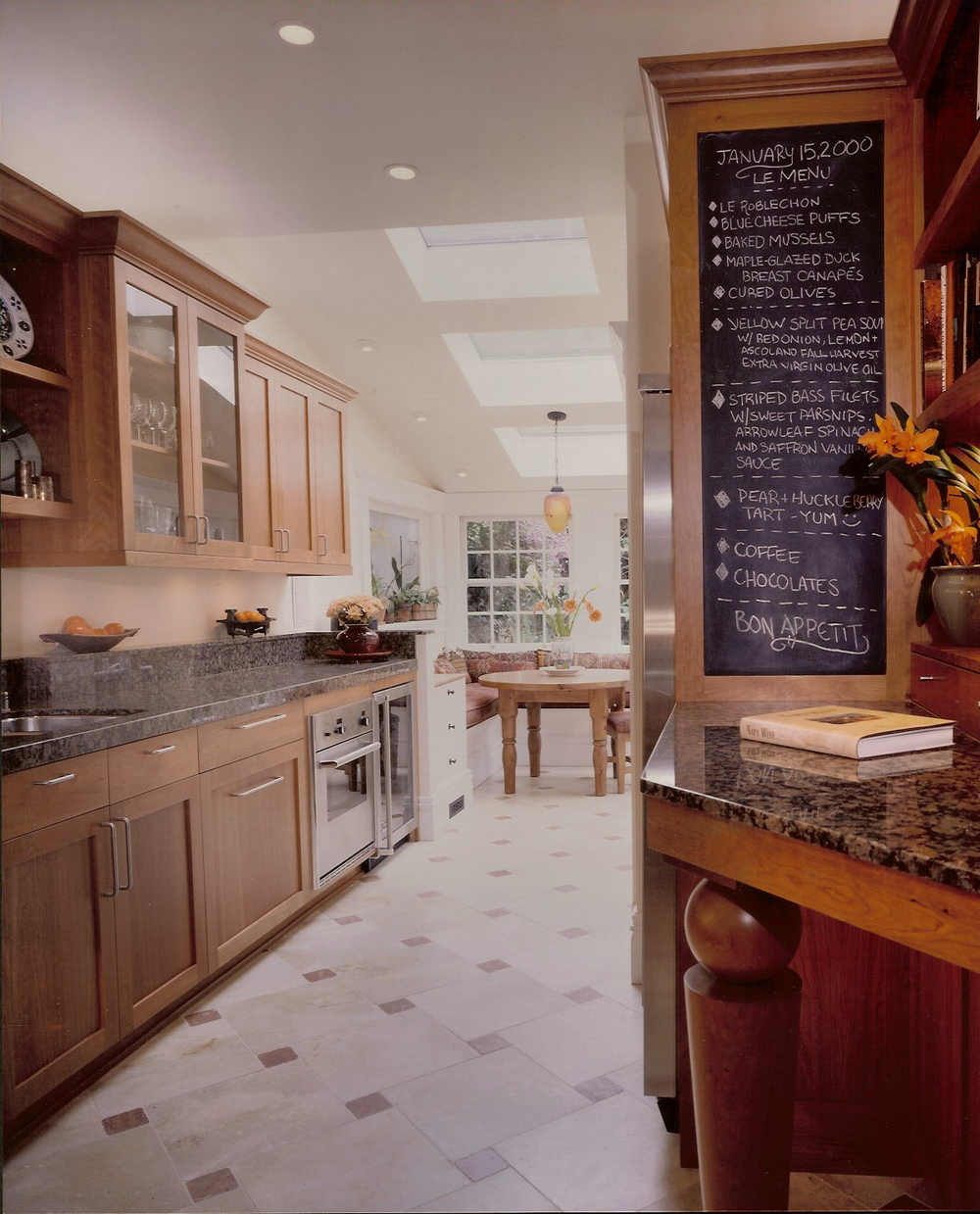 The hand-turned custom leg on the stand-up desk is a great welcoming gesture at the entrance to this Cherry Kitchen. This kitchen I did is 15 years old, and yet still retains a modern edge for today's tastes. Always fun to go back into my portfolio and see my old designs still working! These clients obviously loved to cook and a working kitchen should have many levels of usage.