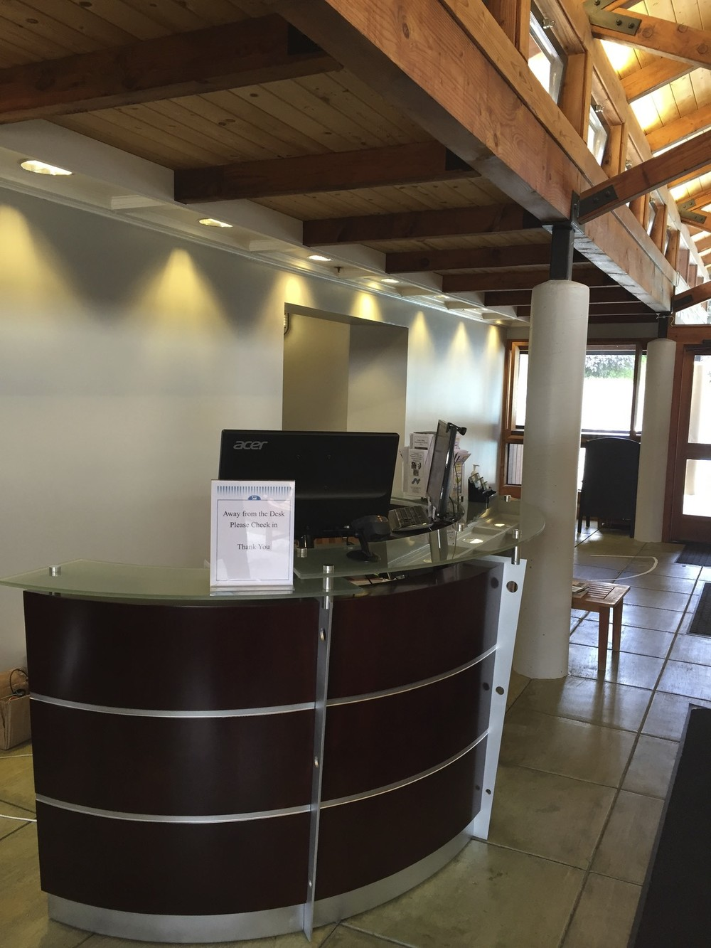 New Reception Desk is at the front of the entry to greet members.