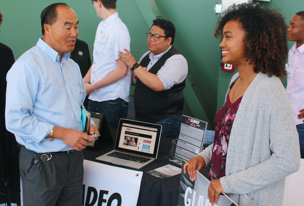 Mahal Williams talks to a visitor about Gladeo's mission.