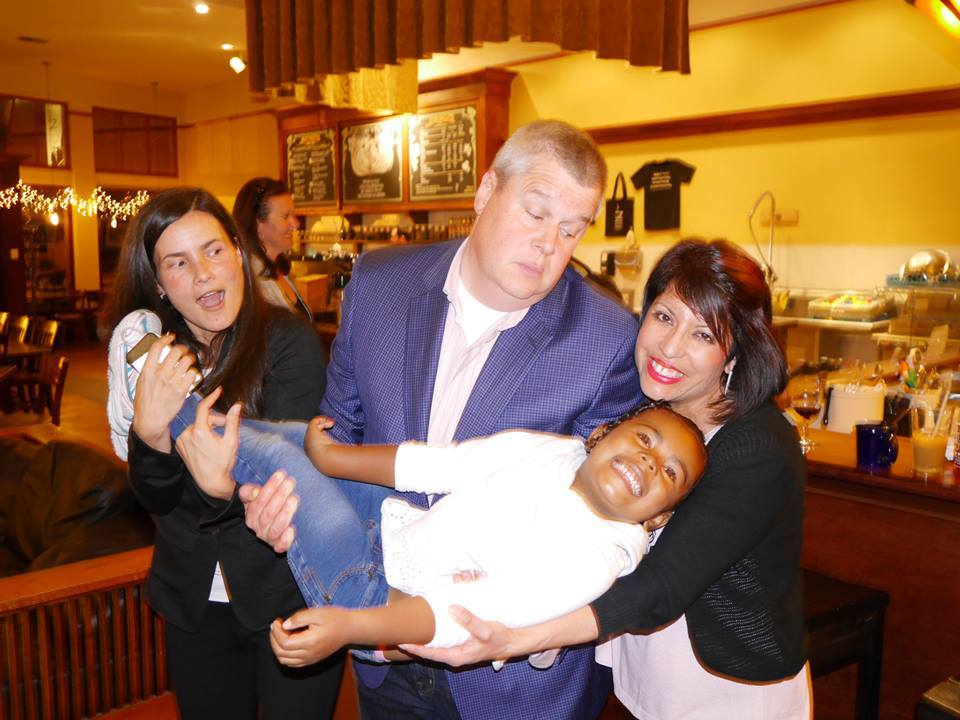 From left to right: Soma, Daniel Handler (aka Lemony Snicket, A Series of Unfortunate Events), and Michelle Cruz Gonzales (Spitboy Rules) about to toss Soma's daughter Zoe into an imaginary sea.