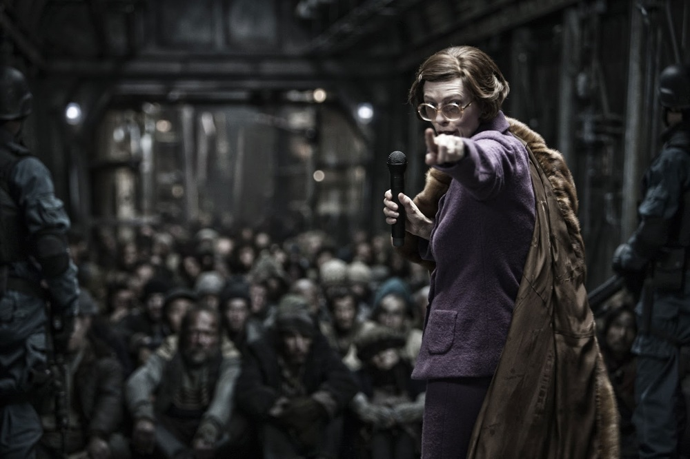 Mojo Film ; Opus Pictures/via  rogerebert.com  - 2013's  Snowpiercer  also takes place years after the apocalyptic event, which makes it easier for the film to explore societal issues alongside survival issues. Pictured here is Tilda Swinton as Mason.