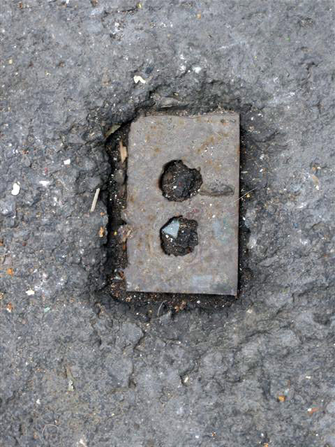 "Wall plate into the cement (Downtown, Mexico City), 2008. From the series ""Found Objects""."