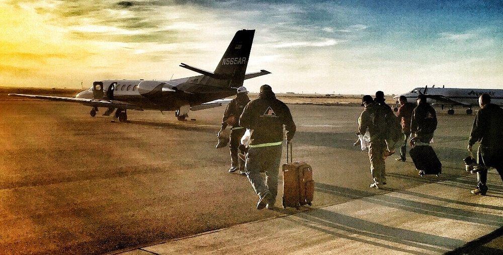 Guys+walking+to+plane.jpg