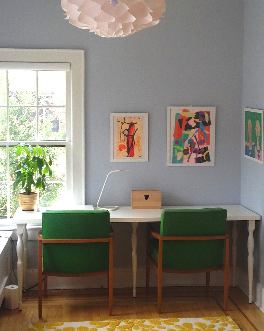 Sky blue walls and verdant kelly green vintage chairs from OKL framed with light-infusing white make for a happy and bright home office. A modern floating light is reminiscent of clouds above and adds a lightness-of-being to this spot of focused work.