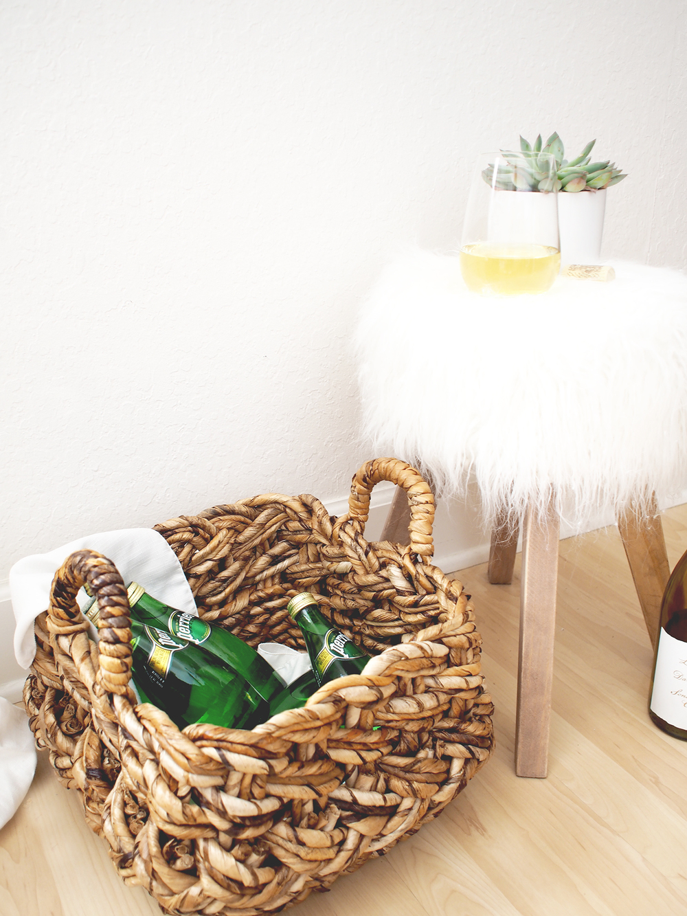 What to put under shelves that house your entertaining goodies? Stocked baskets of items that keep for longer periods of time like sparkling water for guests! | A Fabulous Fete