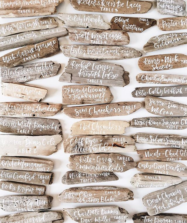 Hand lettered pieces of driftwood to use as escort cards | A Fabulous Fete