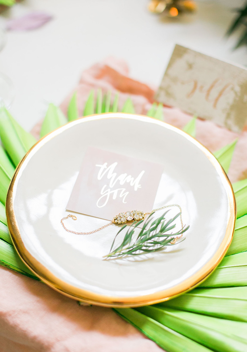 Rehearsal dinner table settings with thank you cards and favors your bridesmaids can wear at the wedding | A Fabulous Fete