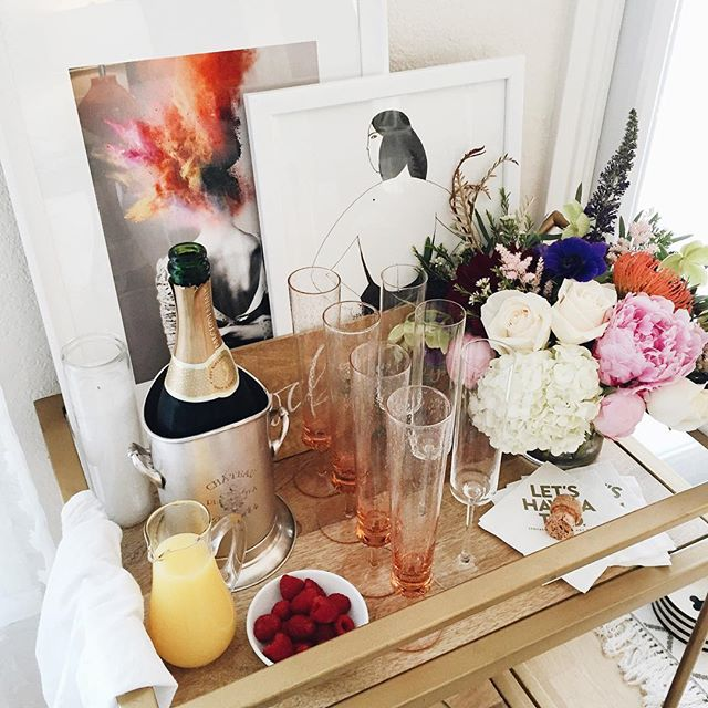 Mimosa filled bar cart for brunch | A Fabulous Fete