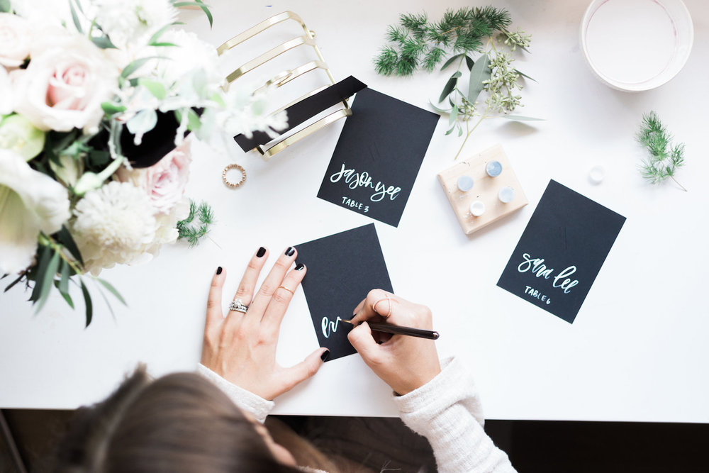 White lettering on black card stock for holiday inspired escort cards | A Fabulous Fete