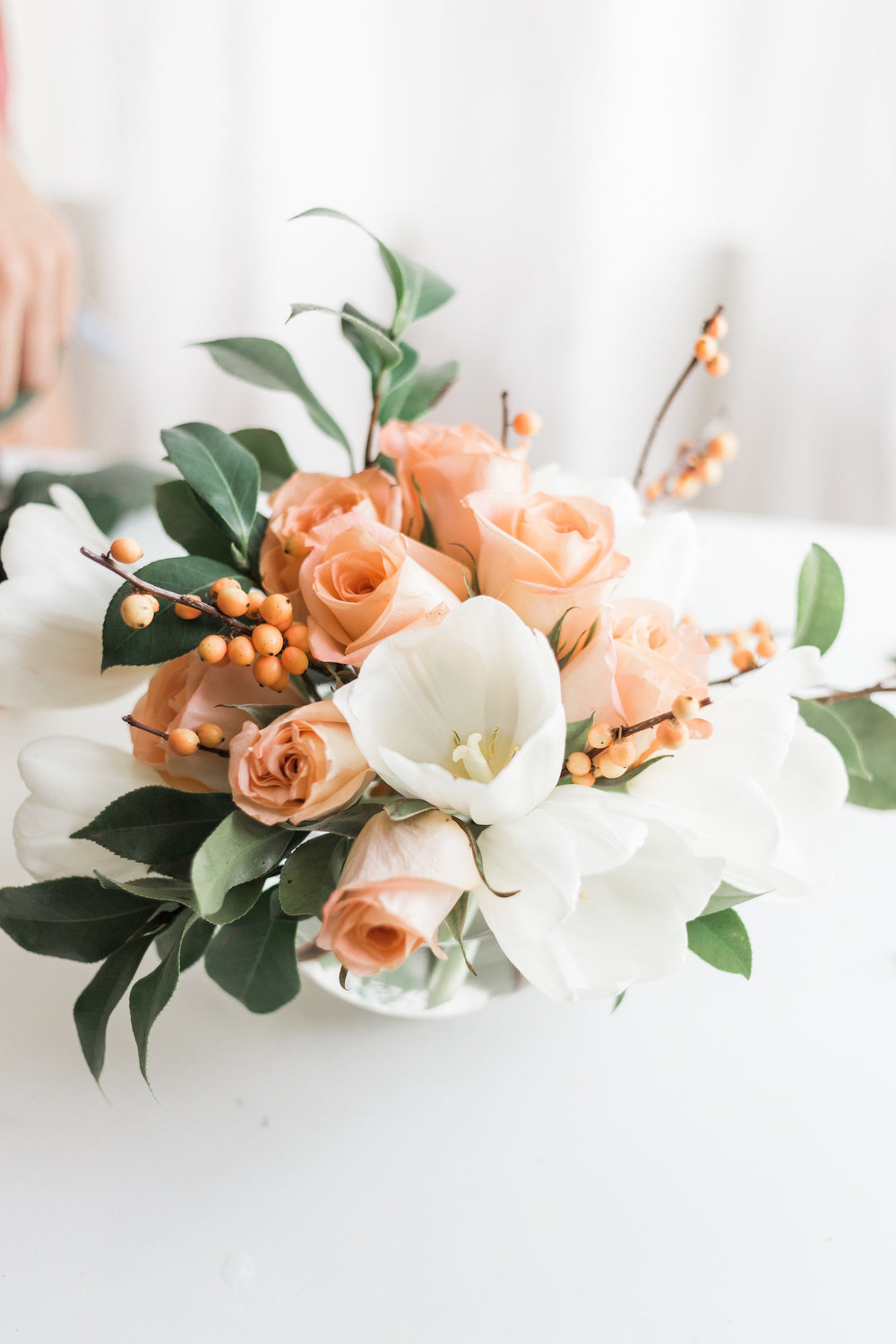 White and peach holiday floral arrangement | A Fabulous Fete