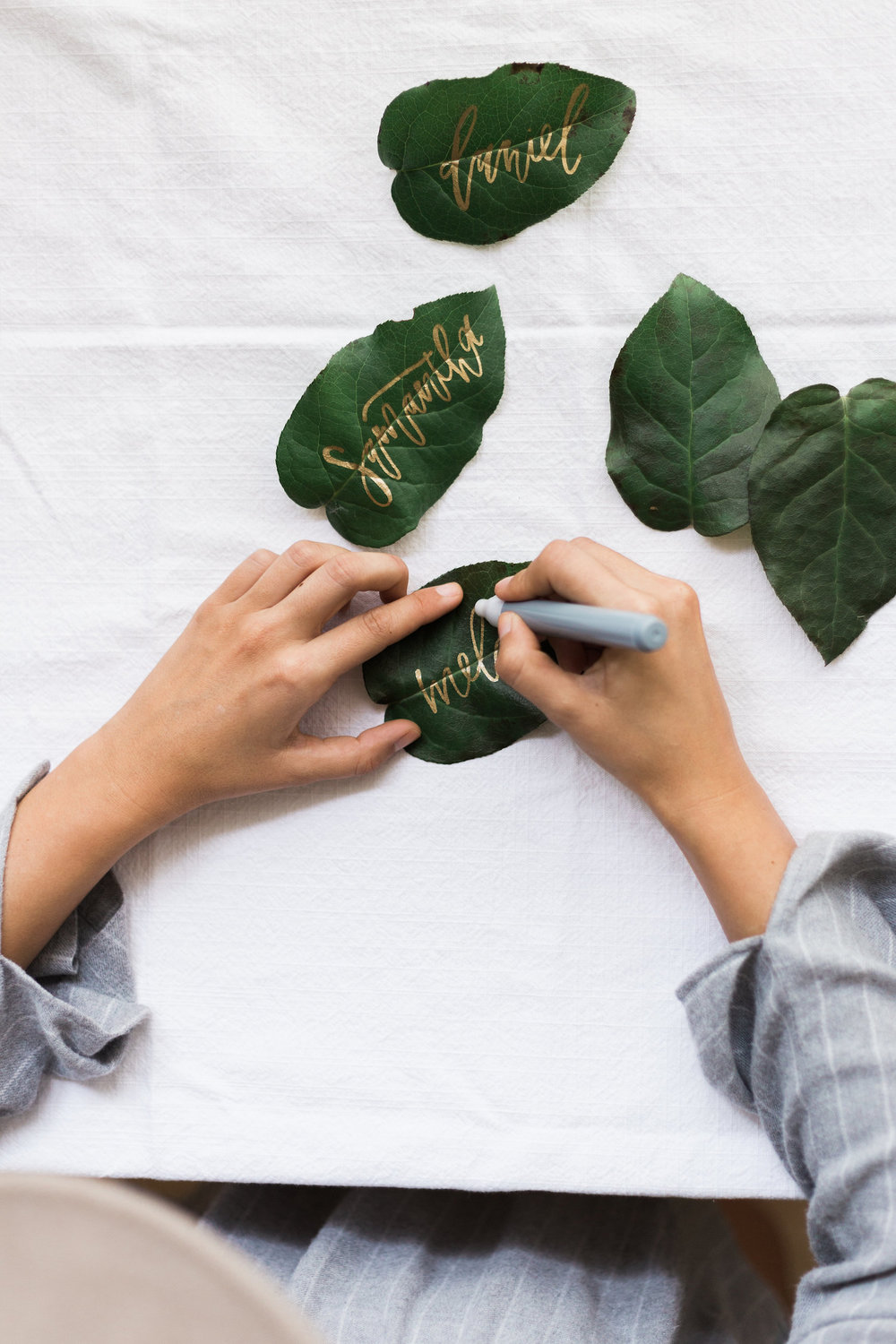 Gold calligraphy live foliage place cards | A Fabulous Fete