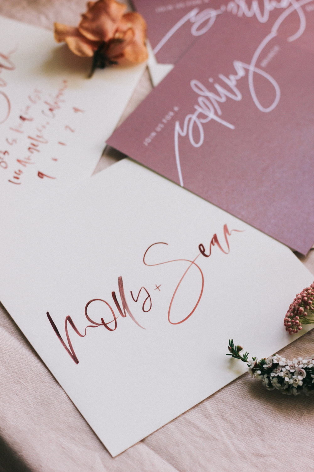 Hand lettered burgundy/rust invitation envelopes | A Fabulous Fete