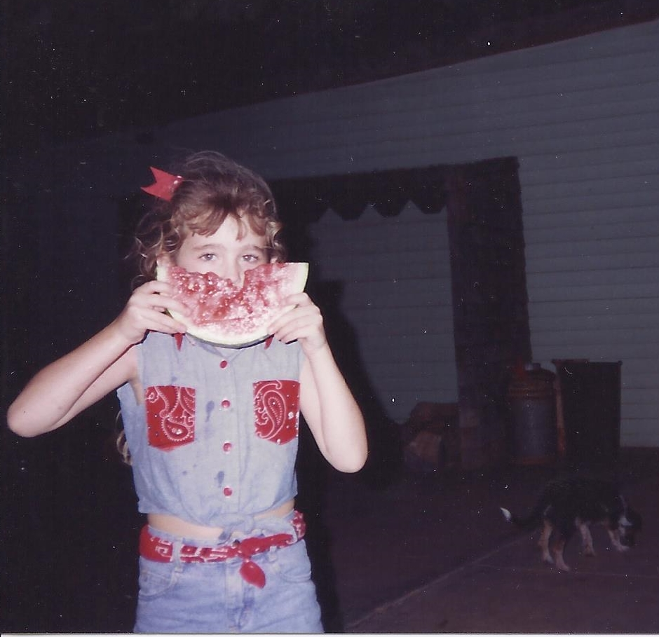 Enjoying some fresh slices of watermelon as a kiddo.