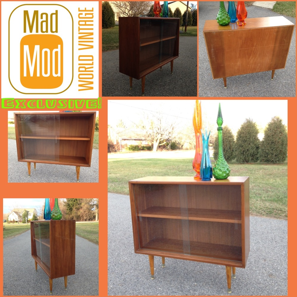 Adorable teak veneer bookcase with adjustable shelf.  Just of a few awesome casework pieces available for purchase at Fleetwood Antique Mall at Mad Mod World Vintage! My personal stretch glass collection…but I do have a matching pair of blue Viking Glass pieces packed to go!