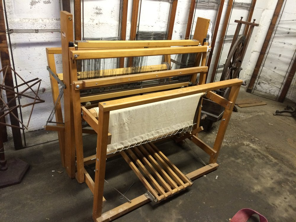A vintage loom on display.