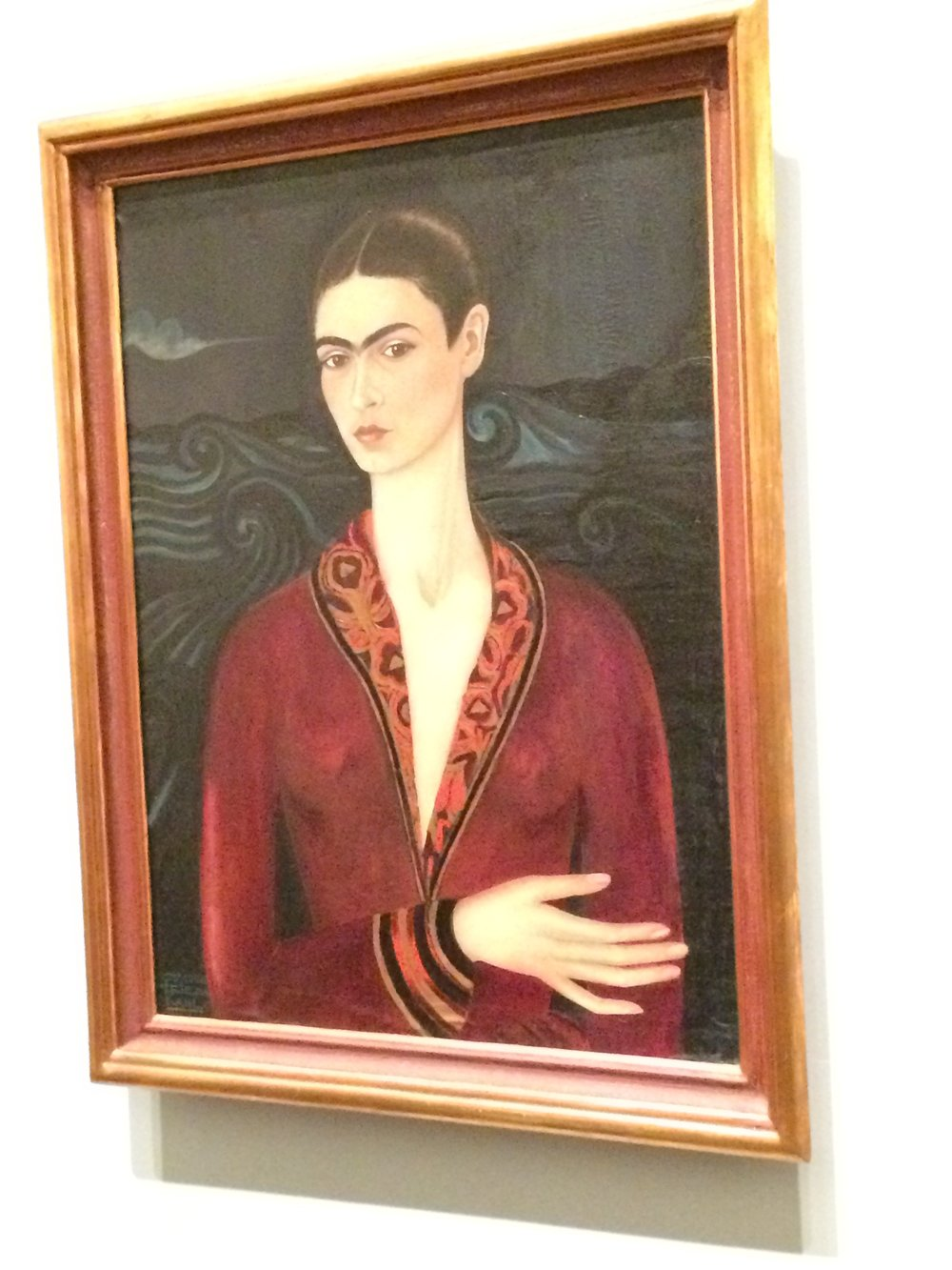 Frida Kahlo's first self portrait which no doubt put her on the map in the art scene.  The details are just phenomenal.