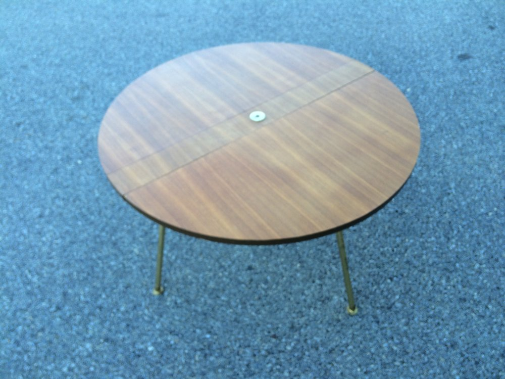The table as found.  The metal disk in the center functions as the bolt that is also the swivel point for the legs.  Sadly the owner had clipped the eyelit loop that would serve as the carry handle when the table is folded.