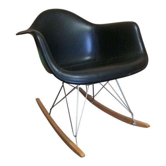 This version of the eames fiberglass shell dates to the mid 1960s and was made by manufacturer summit plastics.  It features black vinyl upholstery over black fiberglass.  I have also paired this with a modern conscience rocker base which i am smitten with.  So stylish!