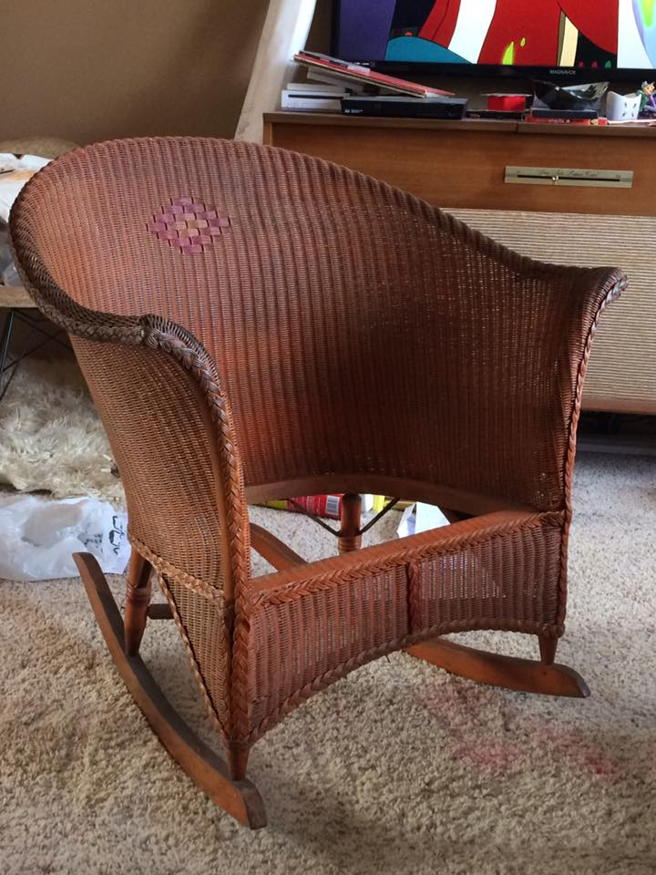 The repair is on the right arm.  Can't even tell!  <3  I choose not to repaint  the chair.  Shabby is in and so many folks faux finish things, here is the real deal aged finish!  Drab orange with deep red accents.