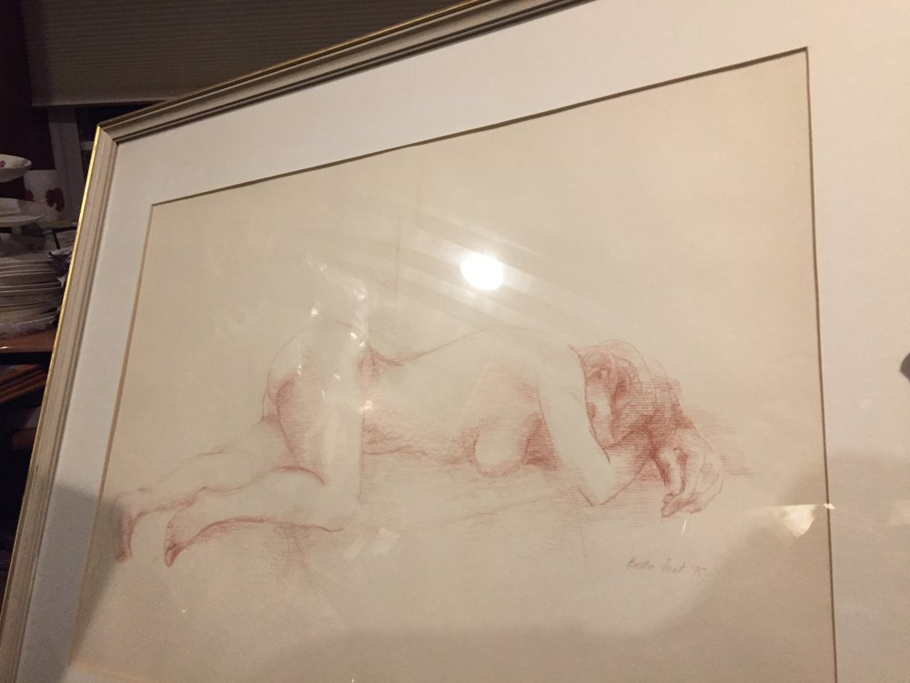 Nude sketch in red pencil on textured paper dated 1975.