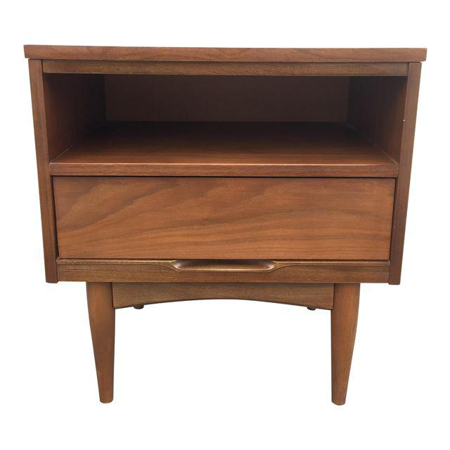 Walnut night stand with plastic laminate top, single drawer and open shelf.