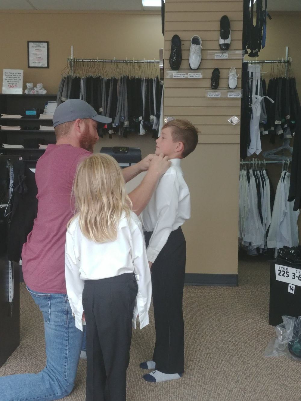 The boys getting fitted for their tuxes.