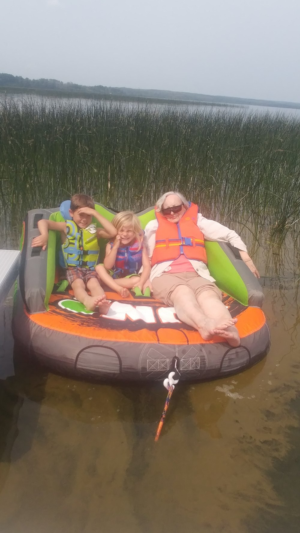 Grandma tubing with the kids at the cabin