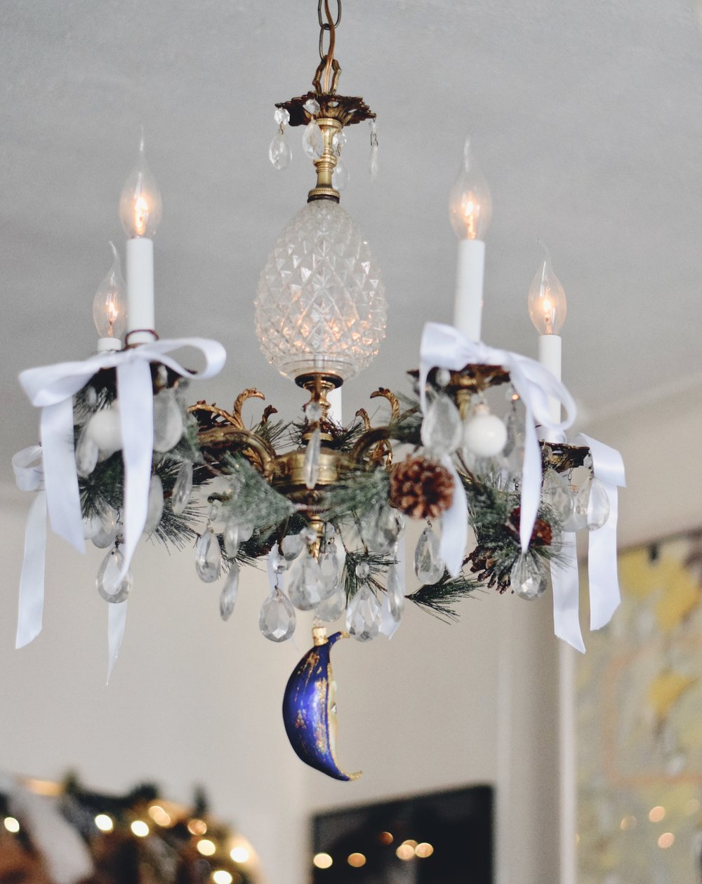chandelier with gold blue moon ornament