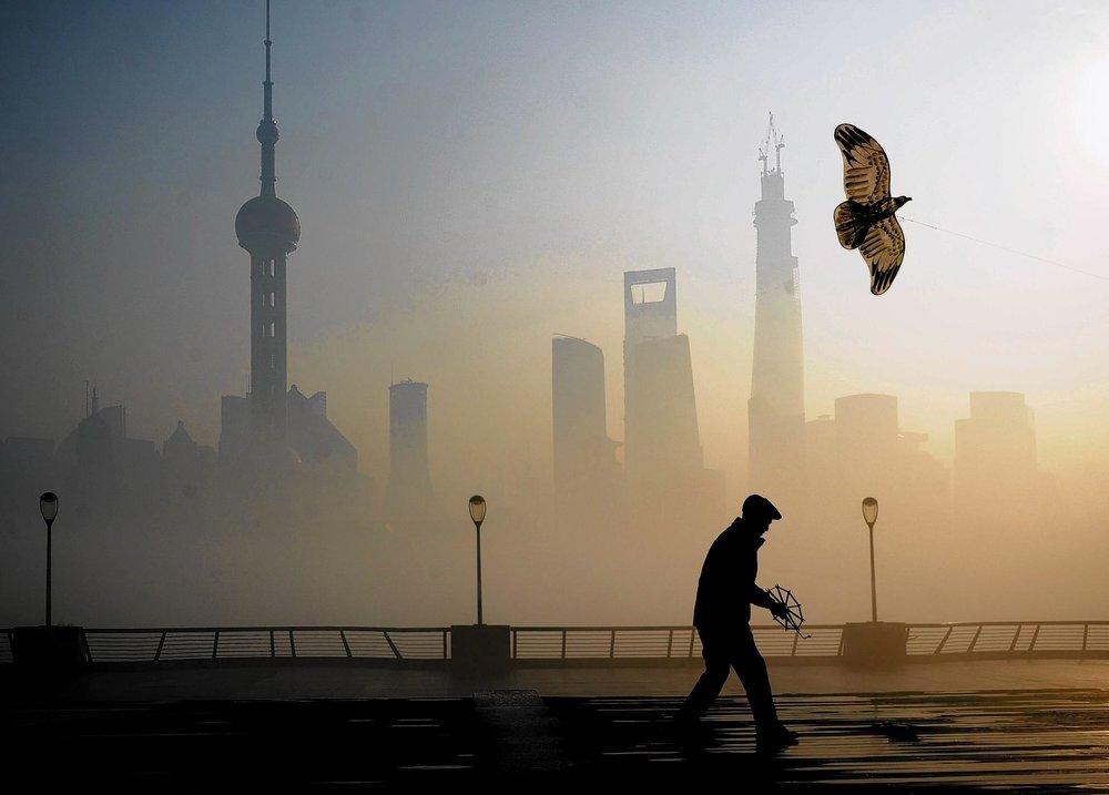 la-afp-getty-heavy-smog-hits-east-china-jpg-20131223.jpg