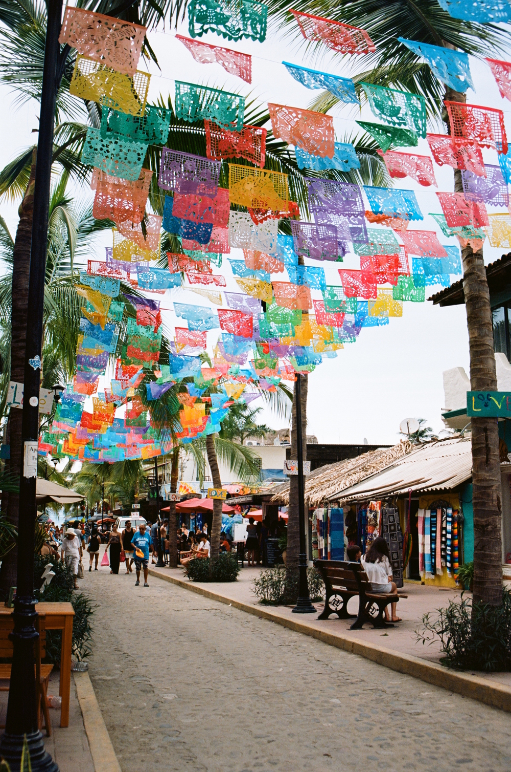 "Considered ""main street"" in Sayulita. These pretty flags hadn't been hung during our first trip so it was a cute surprise to find them here this time around. This road is most popular for taking selfies with friends/family but I wanted to capture the color on its own."