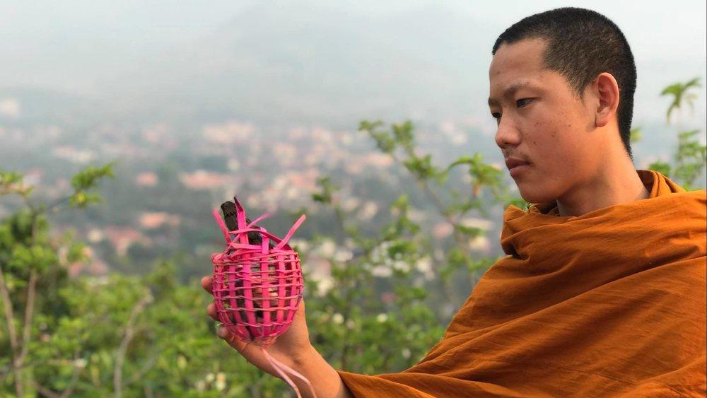 SUP Wilderness Adventures Laos Luang Prabang monk.jpg