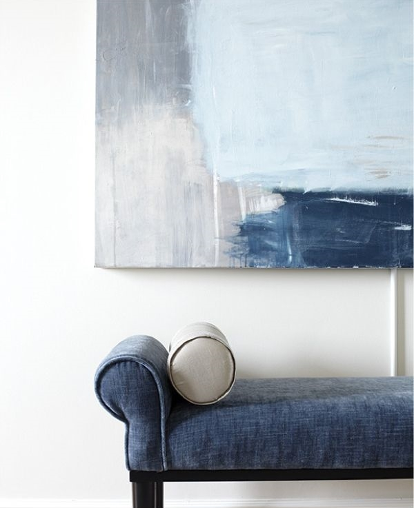 Art will speak for itself and need little else. This simple bench and dramatic modern art combo need nothing else. Their complimentary colours speak for themselves. (Image source: Laura Moss)
