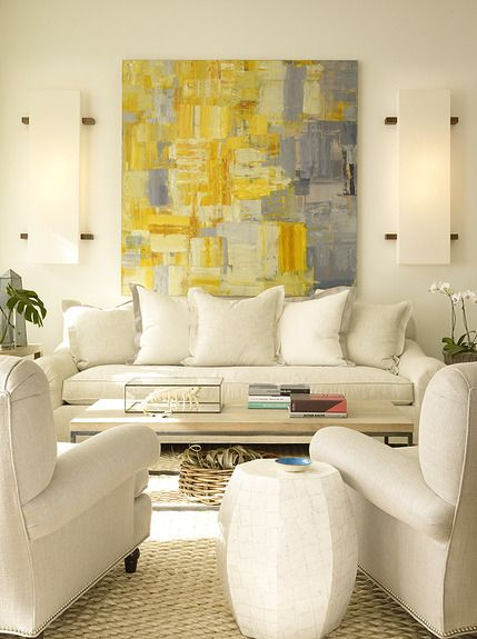 Art can be used to introduce colour in a neutral space - the addition of a strong yellow and subtle grey abstract painting really lifts this neutral space. (Image source: Issuu)