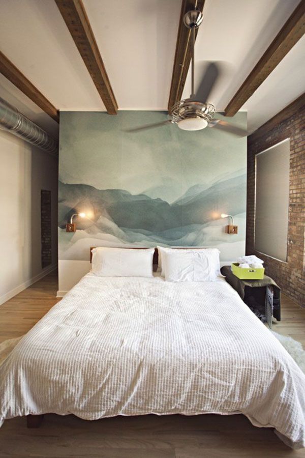 Art can be used to catch the eye and create a focal point within a room. This bedroom art gives an immediate impacts in an otherwise simple bedroom. (Image source: Camille Styles)