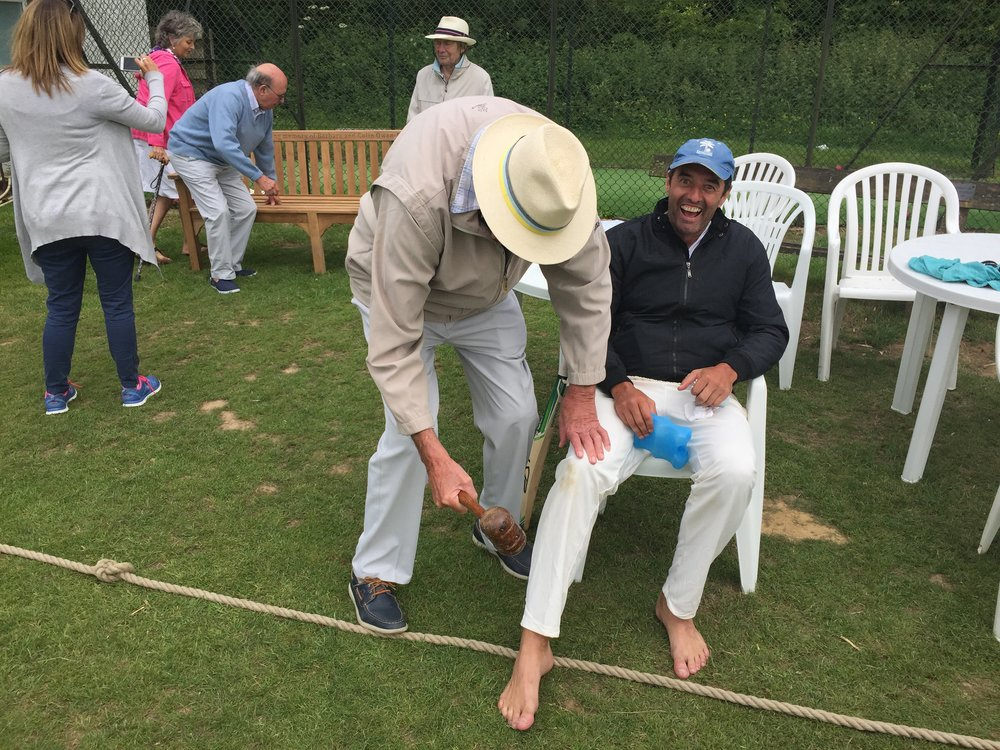Hamish getting medical assistance from Sir Michael