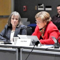 Vice-Chair Judy Walsh delivers committee report as PUC Chair DeAnn Walker listens | ©  RTO Insider