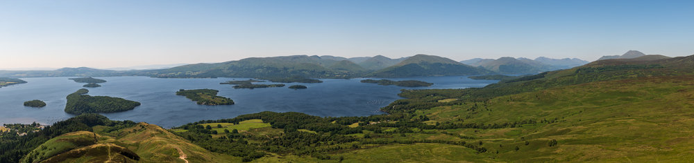 Loch Lomond from Conic Hill  - Super Wide Panorama on a Super Sunny Day: Nikon D850, Nikkor 24-70 mm f/2.8 at 52mm, 1/160th sec @ ISO 64, f/11, 12 image panoramic stitch.