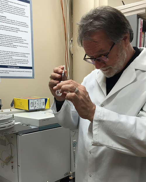 Criminal defense Attorney Shane Phelps (that's me) extracting a minute sample of vapor from a head space vial for injection into the gas chromatograph for analysis.