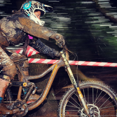 Amazing shot of Amber on her borrowed Kona, riding her first downhill race... look at those conditions! What a trooper