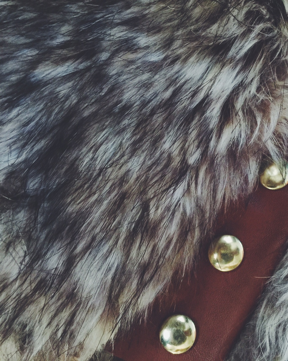 faux fur with leather trim