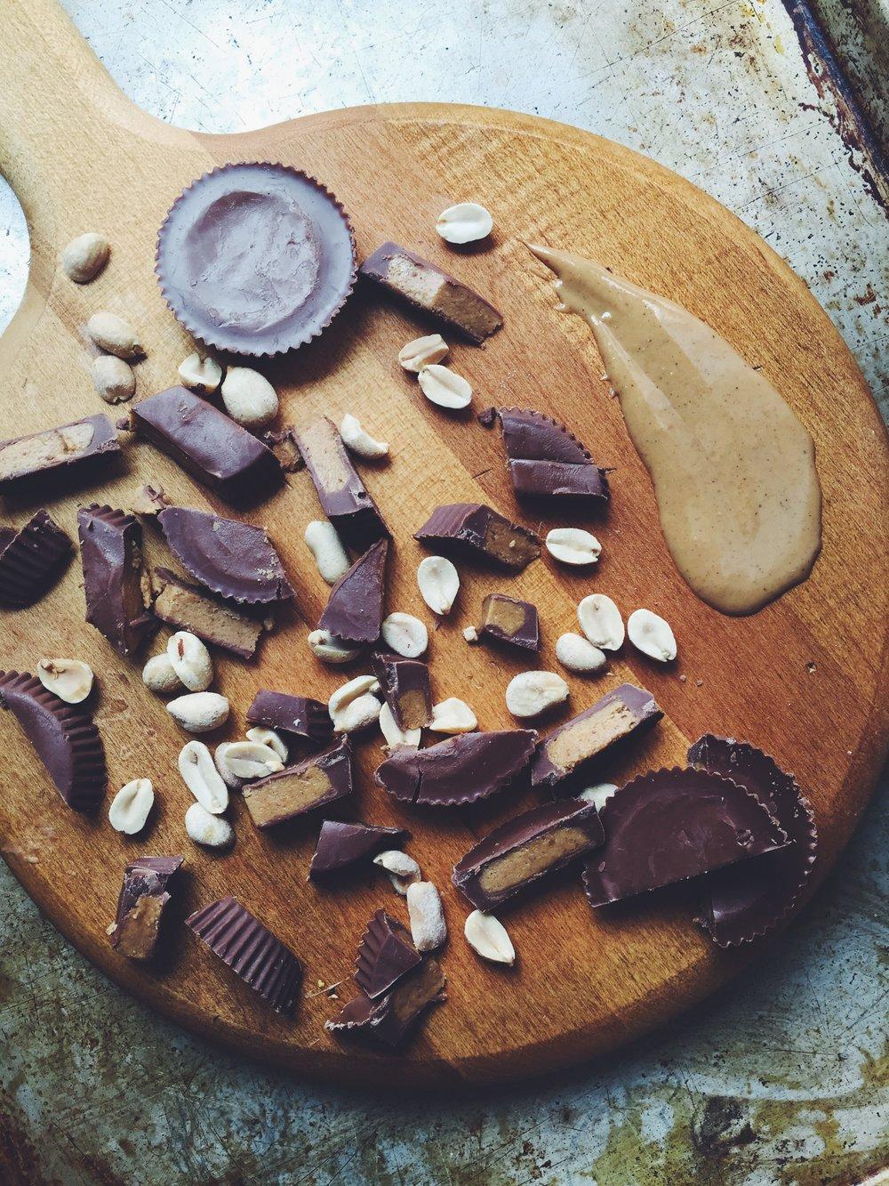 chocolate peanut butter cups + peanuts + peanut butter