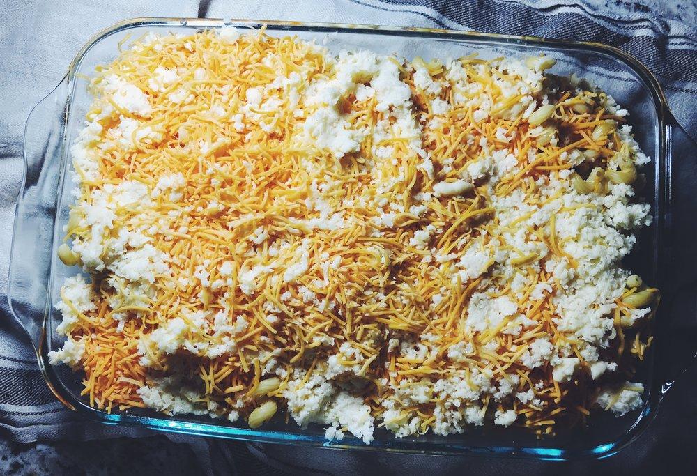 freshly shredded sharp cheddar and havarti cheeses