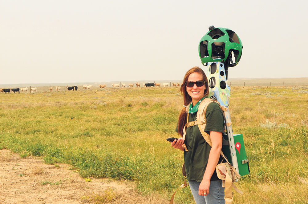 With the Google Trekker on her back, NCC's Natalie Hassett walks through an NCC conservation area to record panoramic images that will soon be available on Google Street View. CALVIN FEHR