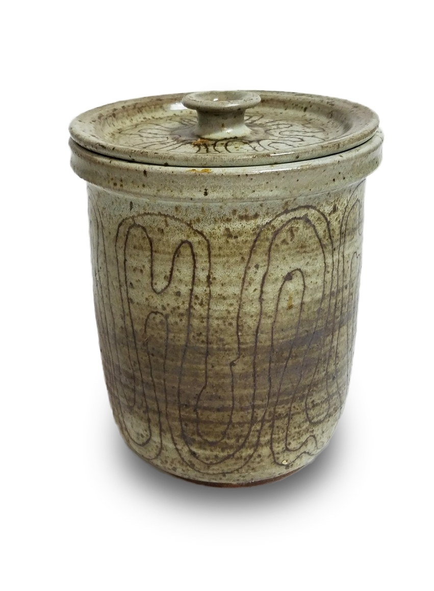 """- 010. 8.5"""" tall, including lid/handle, 6.5"""" wide, unsigned, wheel thrown jar and lid, incised abstract design in red iron oxide over waxy white matte, inside and outside chip on underside of lip of jar"""
