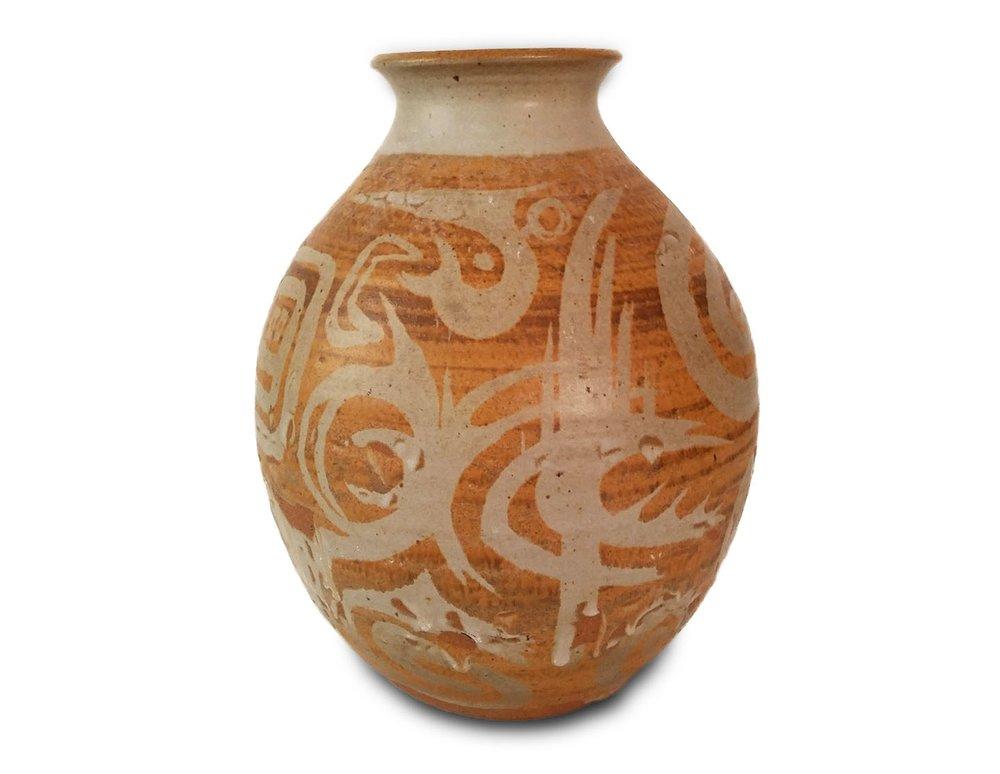 "- 024. 15"" tall, 10"" wide, stoneware vase, buff glaze, wax resist design, red iron over glaze, some crawling of glaze"