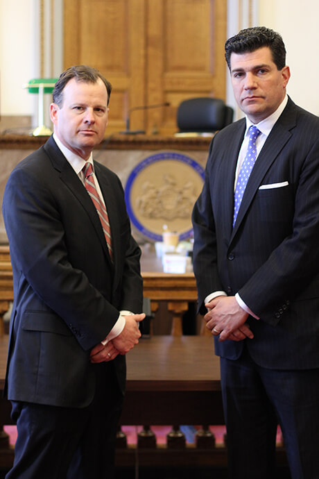 Philadelphia criminal defense lawyers Pierre LaTour and Josh Scarpello standing in a court room.