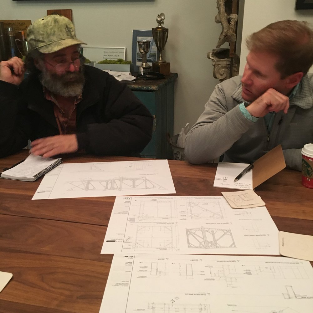"Kevin ""The Welder"" and Mark look over plans for the frame."