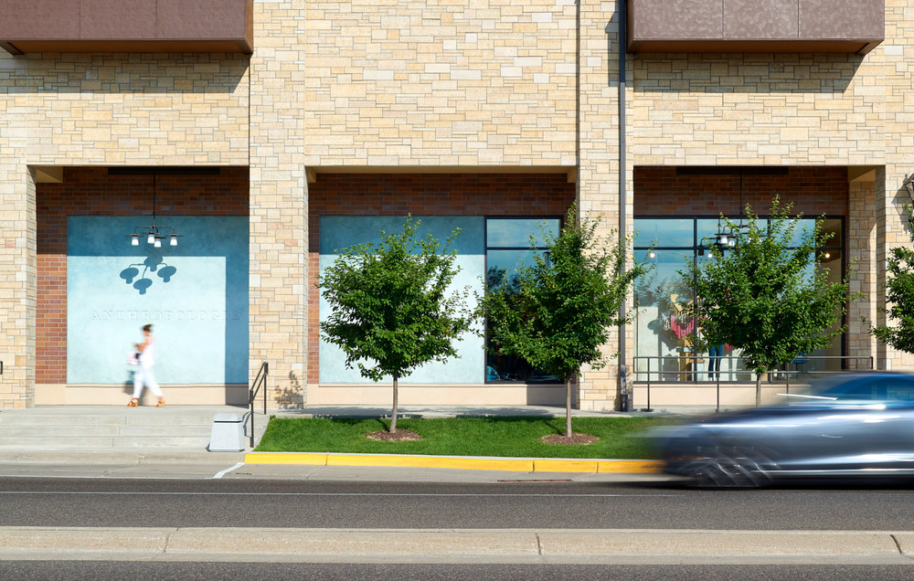Exterior sidewalk area of Anthropologie in Wayzata, Minnesota, created in collaboration with NewStudio Architecture